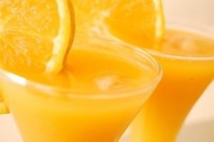 Ways To Survive Summer Heat - drink Orange And Mango Juice