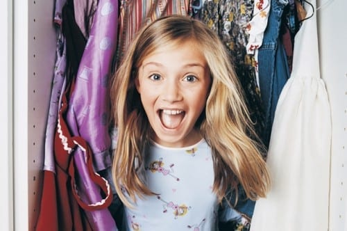 Young Girl Jumping out of a Wardrobe
